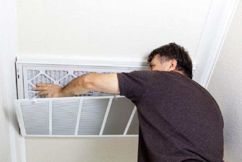 Man Changing A/C Filter AC Repair