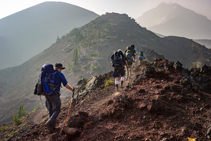 People hiking across the top of a mountain