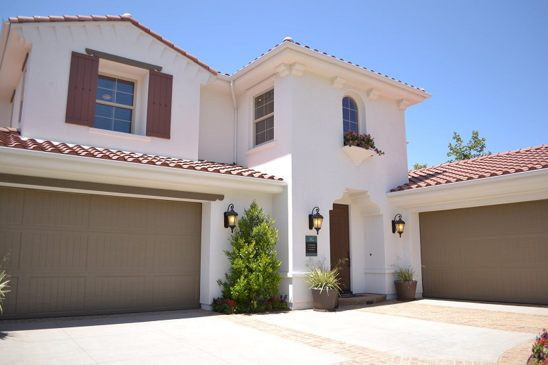 White 2 Story Spanish Style Home with Red Tile Roof