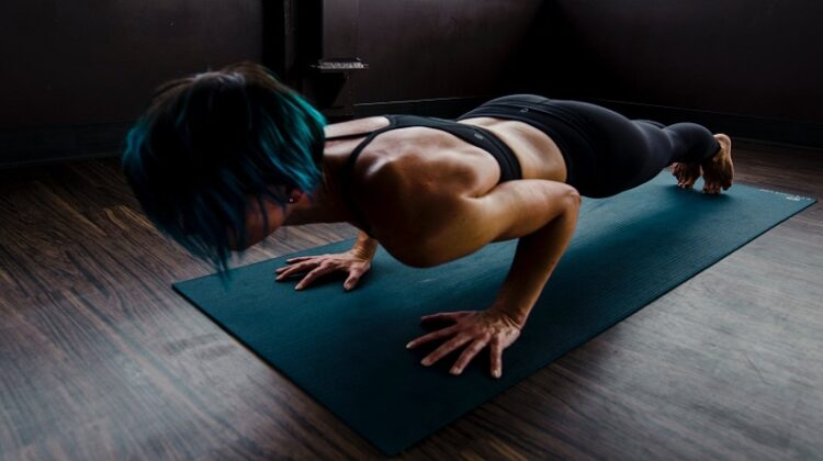 Basement Home Gym Woman Working Out on Mat on Floor