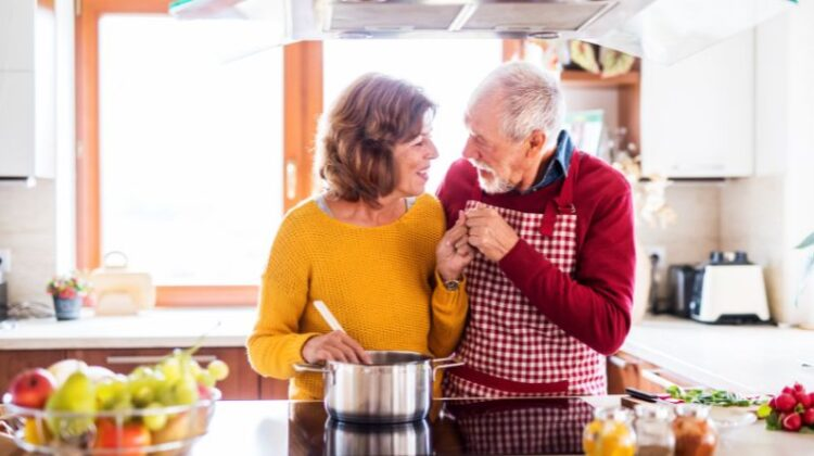 Changes to Make in Your Home as You Get Older Happy older couple in the kitchen
