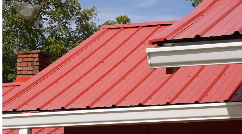 Metal Roofing Systems Home with Red Metal Roof