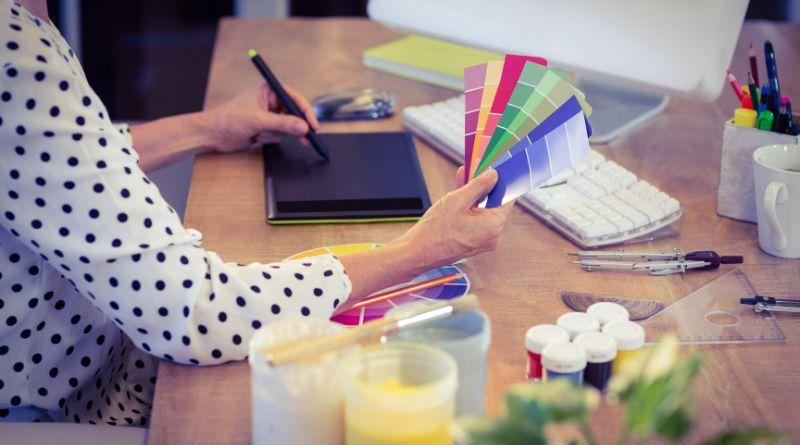 Benefits of Interior Design Services Interior Designer working on plan