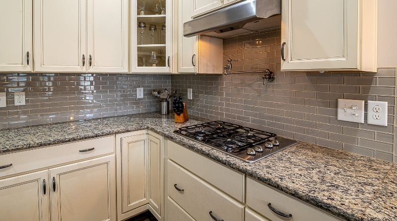 Kitchen with subway tile backsplash and awesome stove top with pot filler tap