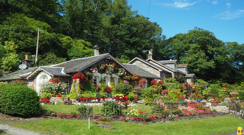 Summer Trends For Your Garden Large stone home with English Country Garden