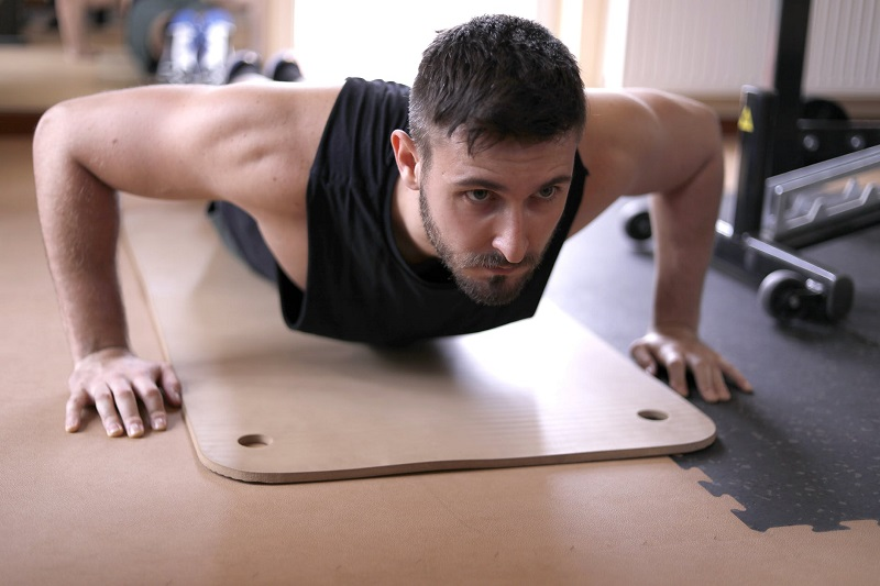 Changes To Your Home To Boost Your Quality Of Living Man in Tank Top Working out on Mat on Floor