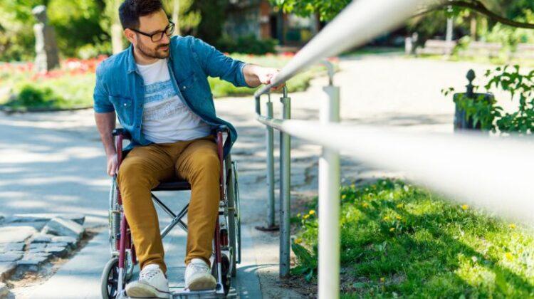Man in Wheelchair on Residential Wheelchair Ramp