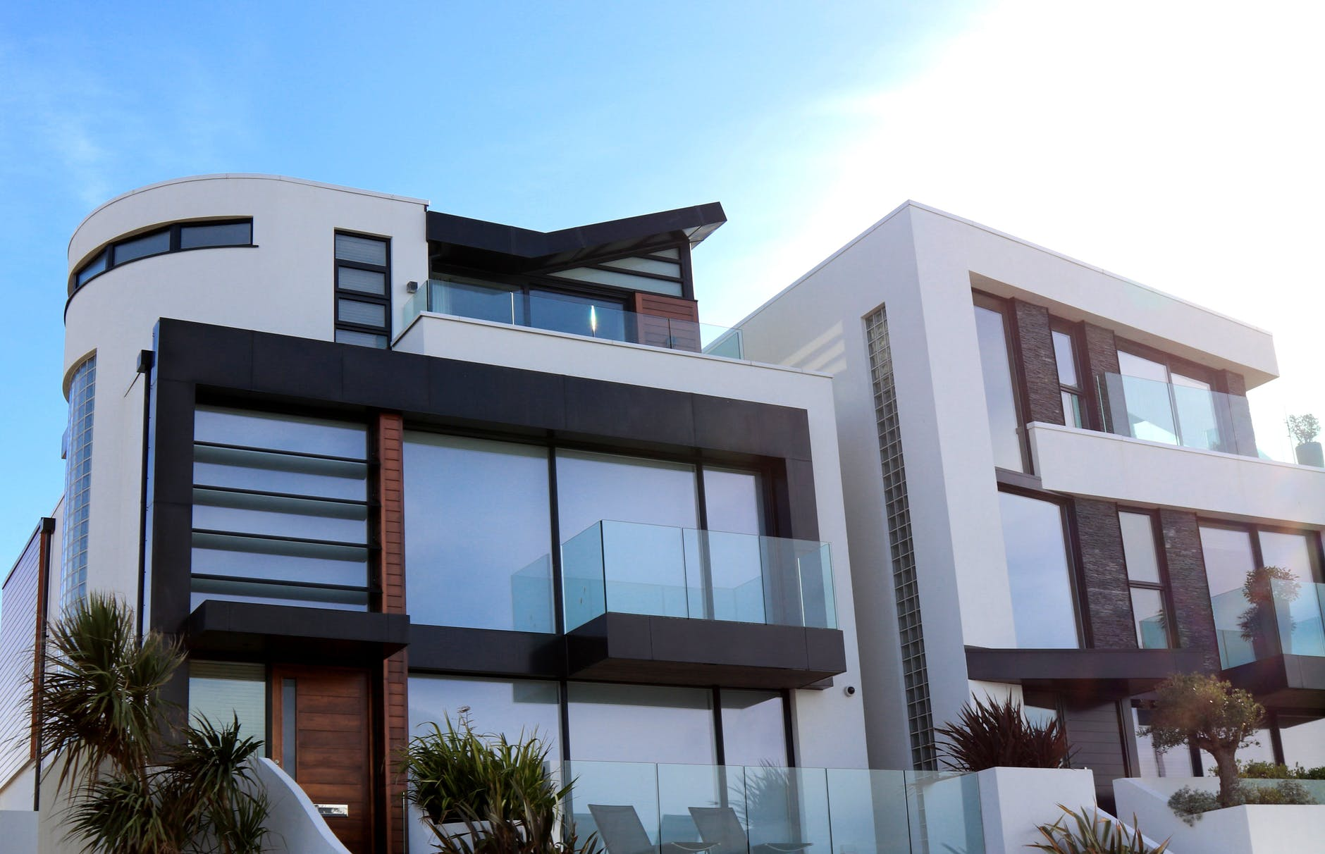 Modern building with glass doors walls and balconies
