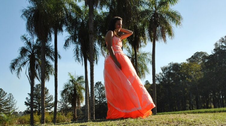 Help Your Daughter Prepare For Her Prom Teen in orange prom dress