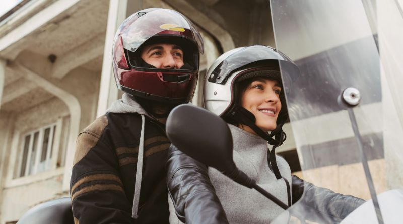 Motorcycle Clothing Young couple on a motorcycle