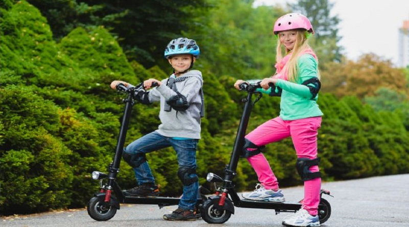 Electric Scooters for Kids Boy and girl on electric scooters