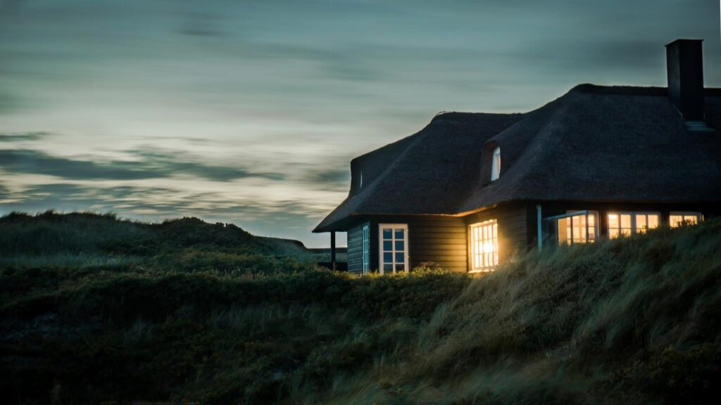 Common Roof Problems Home on side of hill at dusk