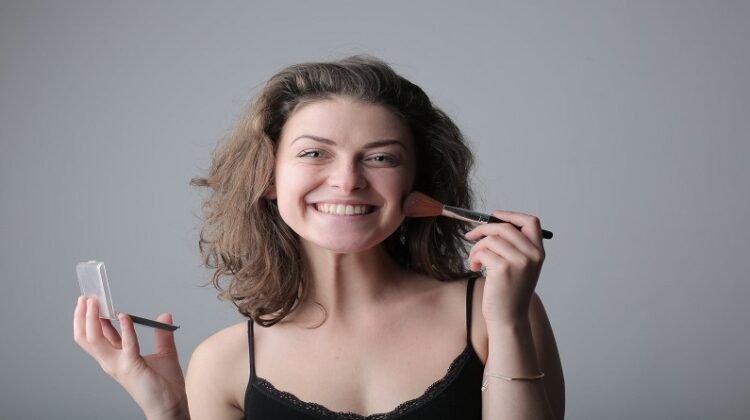 Boost Your Career in the Beauty Industry Smiling Woman Putting on Makeup