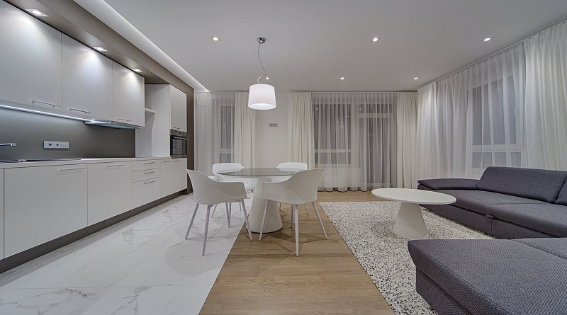 Mastering the Art of the Minimalist Home Streamline Grey and White Minimalist Open Concept Kitchen Living and Dining Room