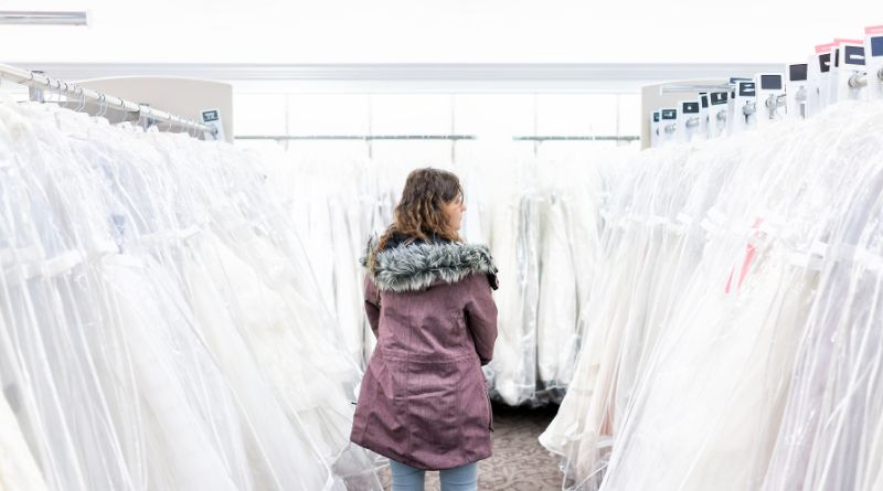 It's your Wedding Day Woman in store looking at wedding gowns