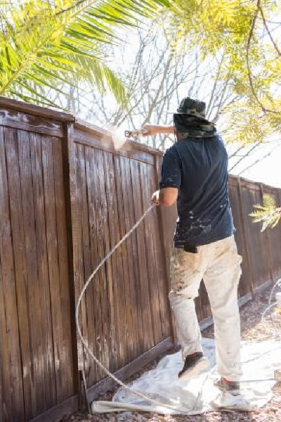 Spraying a Wooden Fence