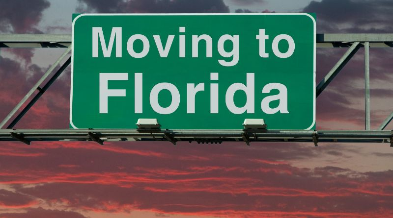 Moving to Florida Sign with a Sunset Background