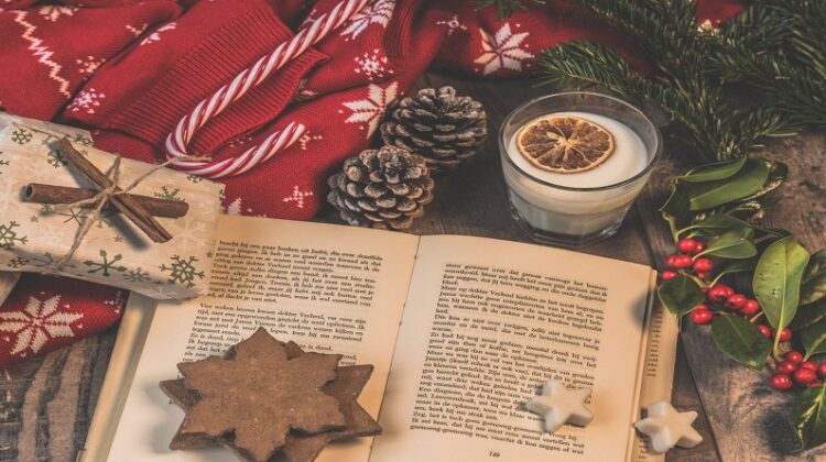 Open Book on Table with Christmas Decorations