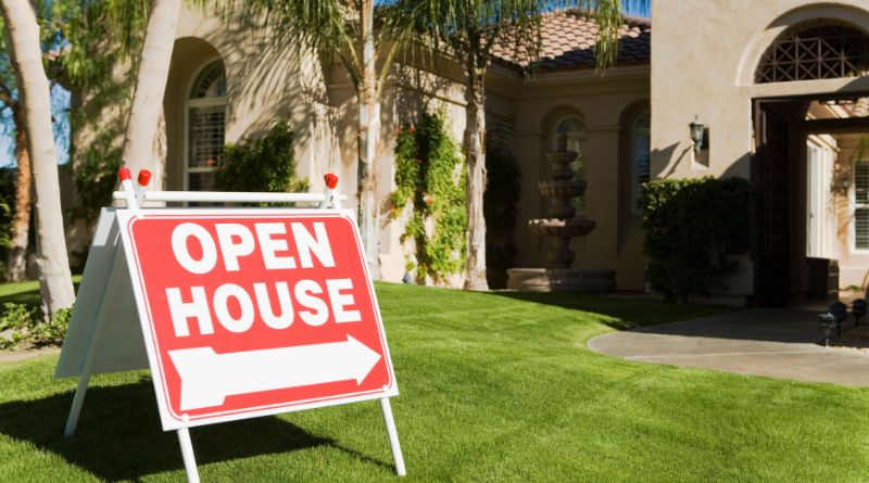 Open House Sign in Front Yard of Home