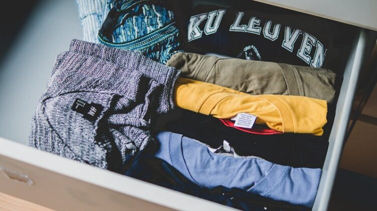 Look After Your Clothes / Open drawer with folded t-shirts and sweaters