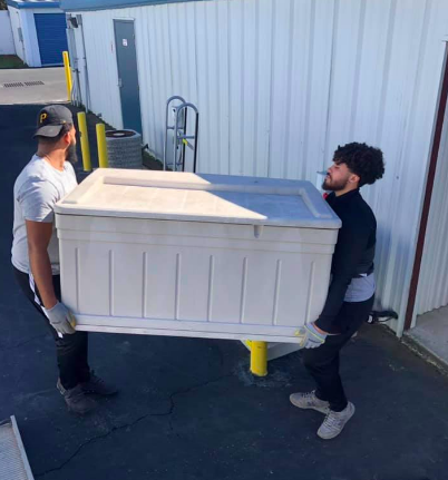 Two men moving furniture 5 Easy Tips To Help You Move To Florida